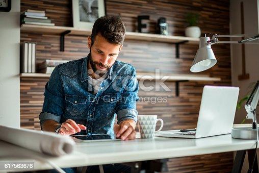 Businessman using digital tablet in an office.