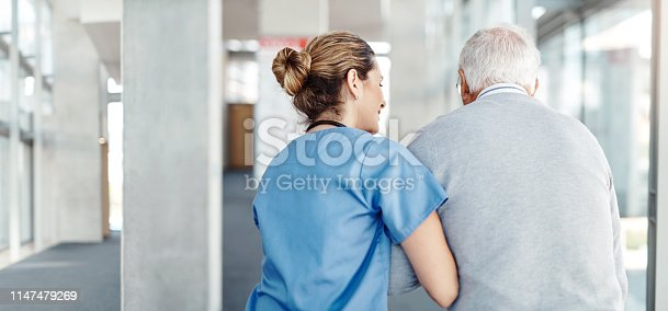 Shot of a female nurse assisting her senior patient while walking