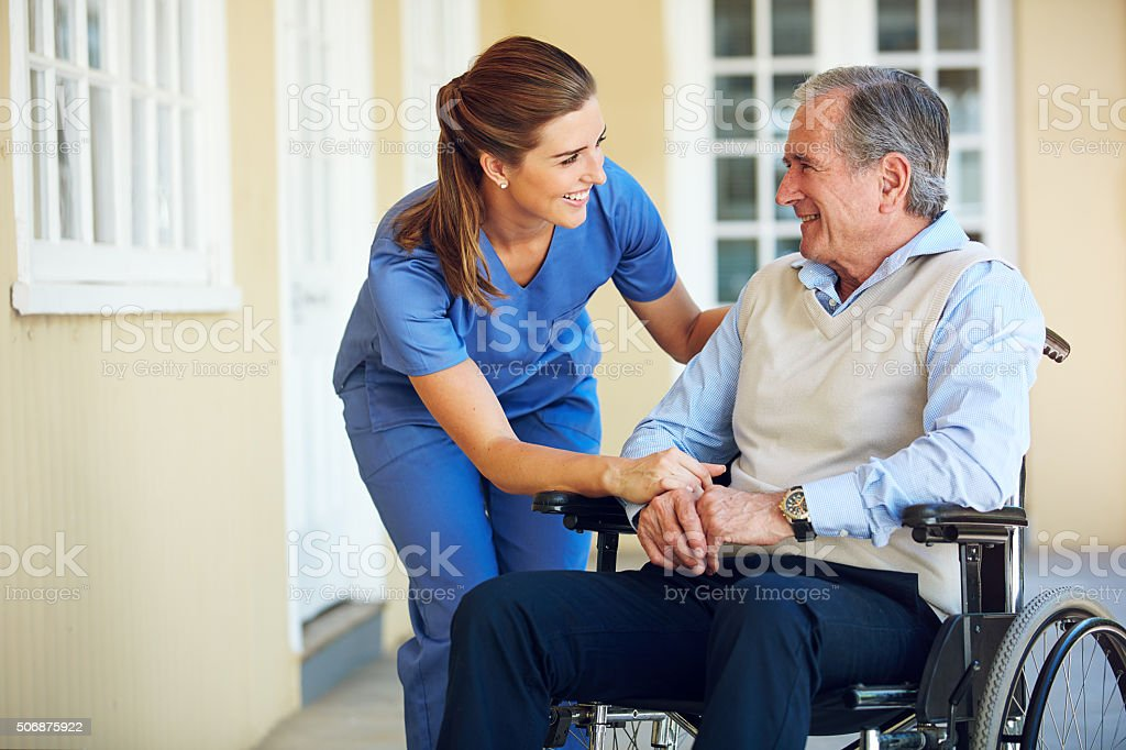 Making sure her patients are comfortable and well cared for stock photo