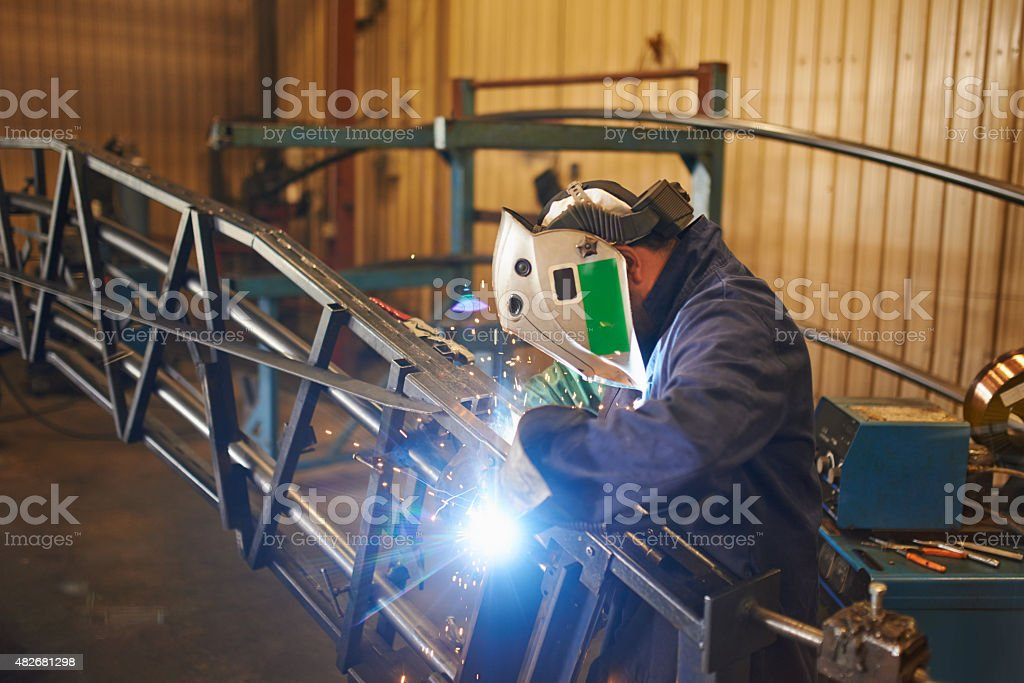 Making sure he's protected while welding stock photo