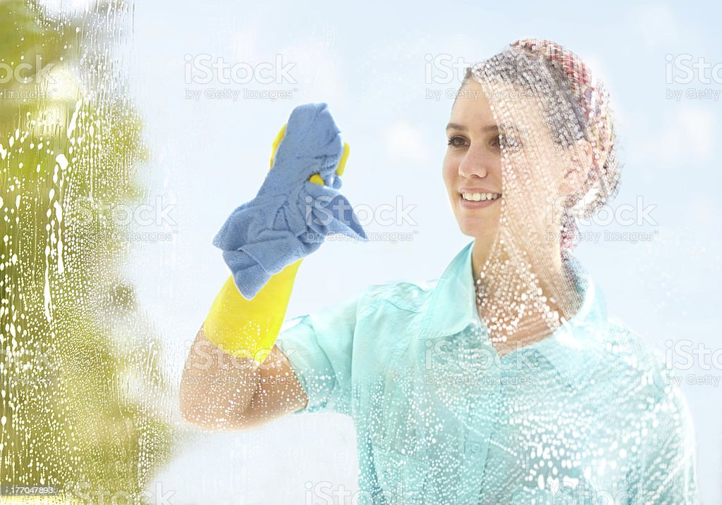 Making sure it's clean and streak-free stock photo
