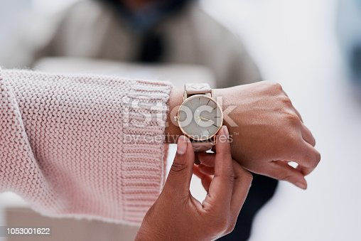 Cropped shot of an unecognizable female customer checking the time waiting for a delivery