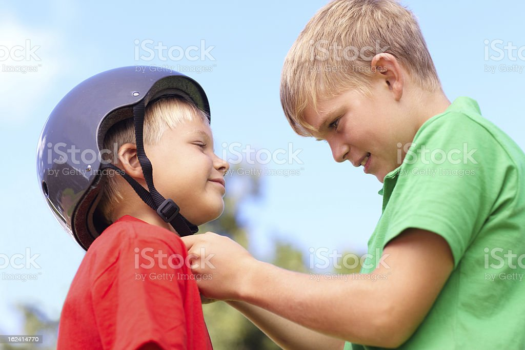 Making sure my little brother stays safe stock photo