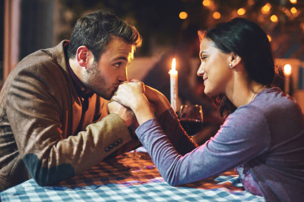 making sure she feels special - dinner date stock photos and pictures
