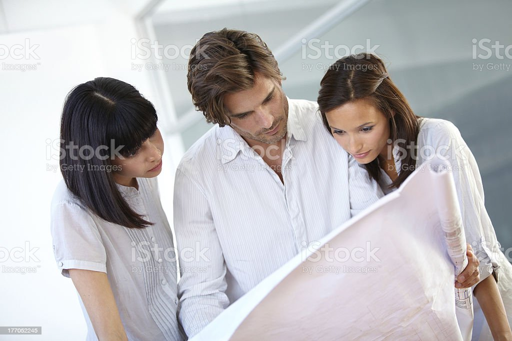 Making sure the blueprints are perfect royalty-free stock photo