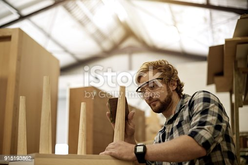 915192732 istock photo Making sure the piece is perfect from top to bottom 915193862