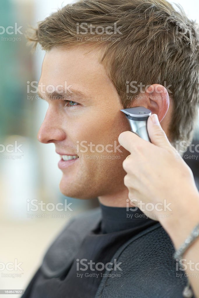 Making sure those edges are trimmed perfectly royalty-free stock photo