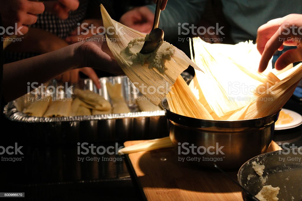 Making tamales in the kitchen stock photo