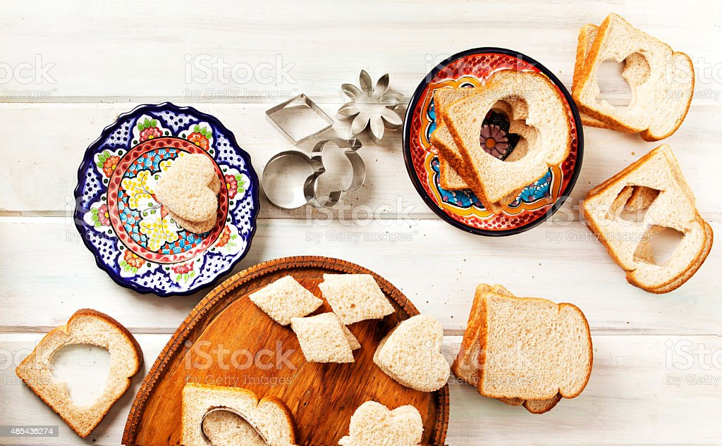 Making Tea Sandwiches With Bread and Cookie Cutters stock photo