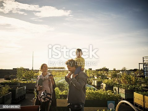 Shot of a young family at a farmer's market