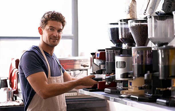 making the perfect cup... - barista making coffee stock photos and pictures