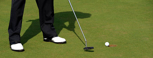Making the putt. stock photo