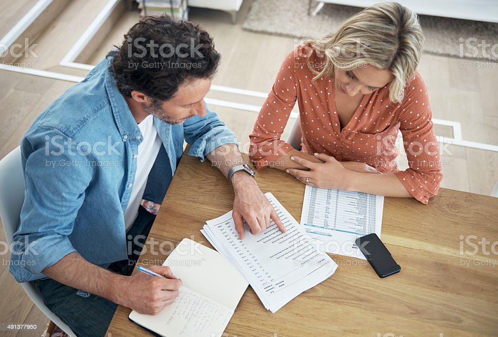 Making their money work for their marriage stock photo