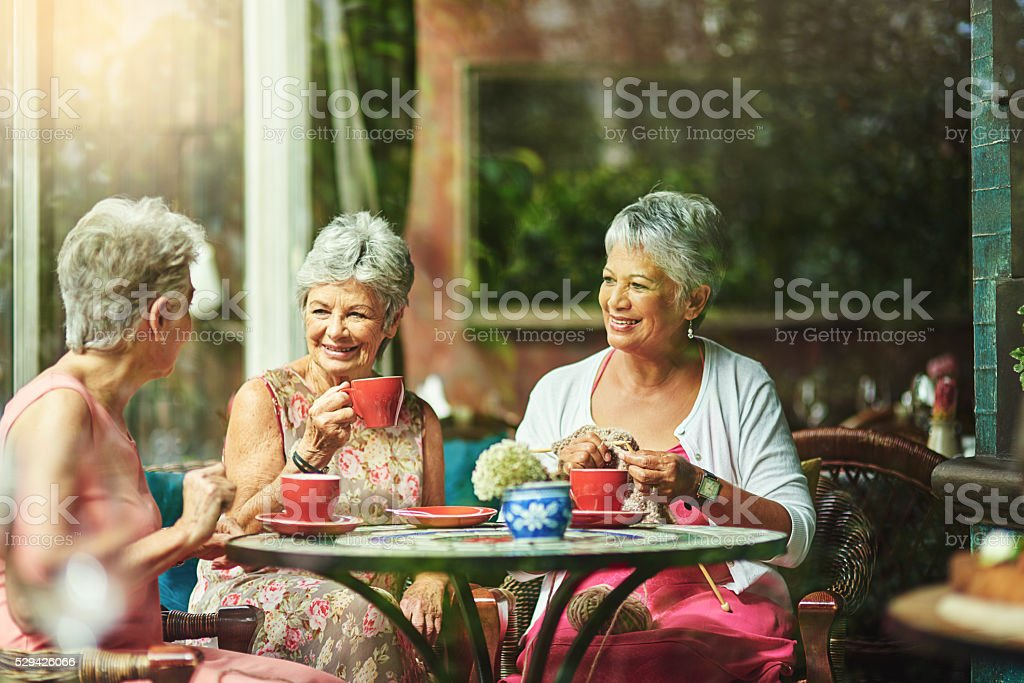 Making time to catch up with good old friends stock photo