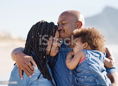 Shot of a beautiful family spending some time together at the beach
