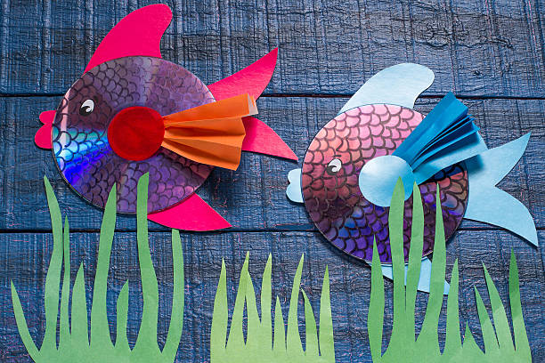 Making toy fish from CD. Handmade children's project. Step 10 stock photo
