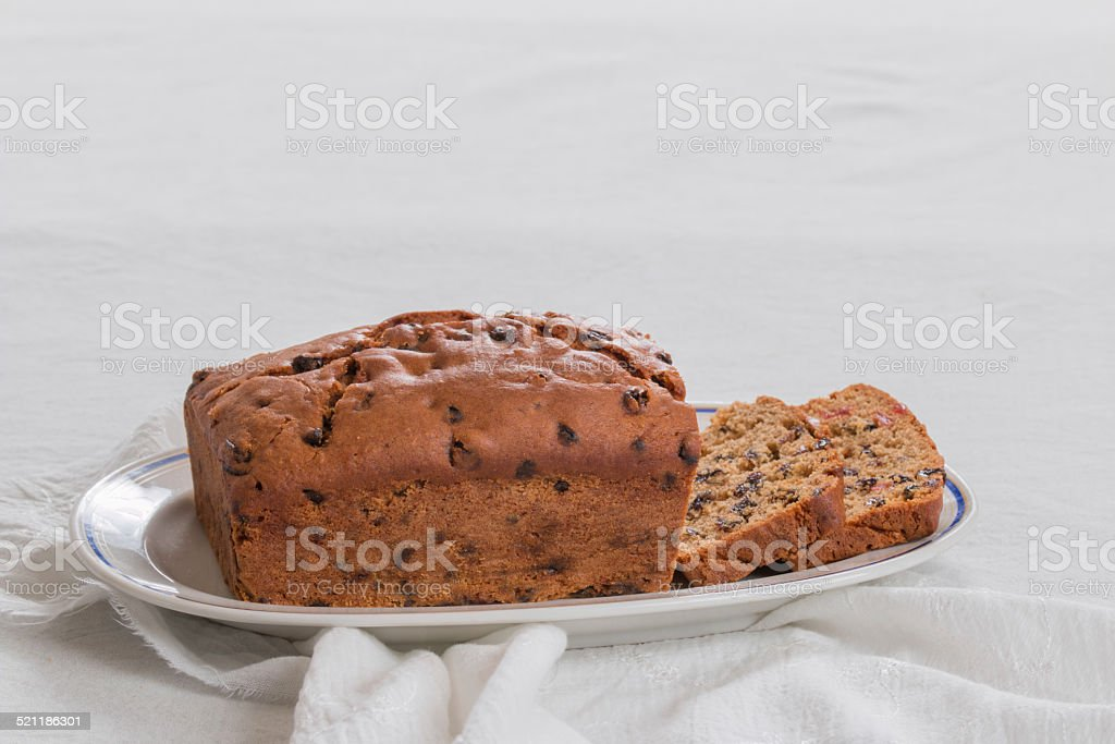 making Traditional British fruit/plum loaf,   loaf on an oval plate stock photo