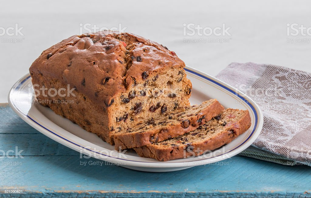 Making traditional fruit loaves, fruit loaf on an oval plate stock photo