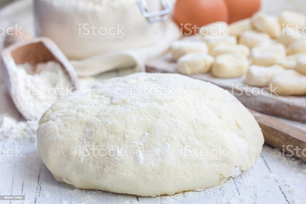 Making traditional russian, ukrainian cottage cheese 'lazy' dumplings, horizontal royalty-free stock photo