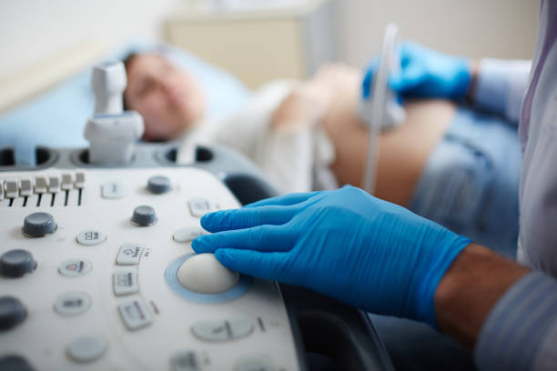 making ultrasound check-up - gynecologist stock pictures, royalty-free photos & images