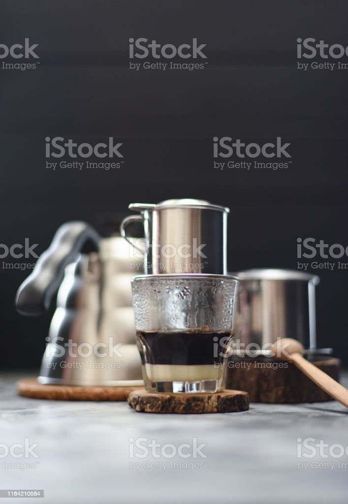 Making Vietnamese Drip Coffee Traditional Vietnamese Coffee Maker Phin And Goose Neck Kettle On Dark Background Copy Space Stock Photo Download Image Now Istock