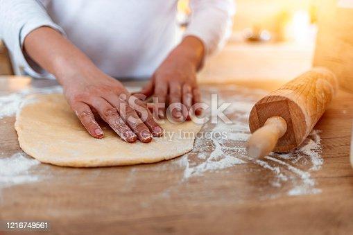 673400318 istock photo Making yeast dough 1216749561