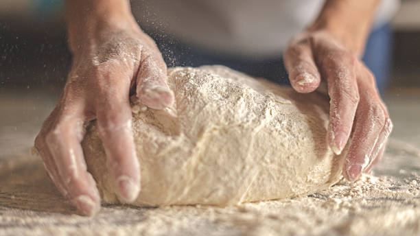Making yeast dough Kneading yeast dough yeast stock pictures, royalty-free photos & images