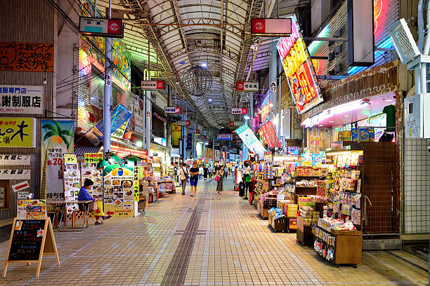 Makishi Public Market, Naha, Japan Naha, Okinawa Prefecture, Japan - August 10, 2015 : Makishi Public Market is a famous shopping street at night in Naha. There are a wide range of souvenirs, as well as is Okinawa's largest seafood wholesale market, Naha, Okinawa Prefecture, Japan. naha stock pictures, royalty-free photos & images