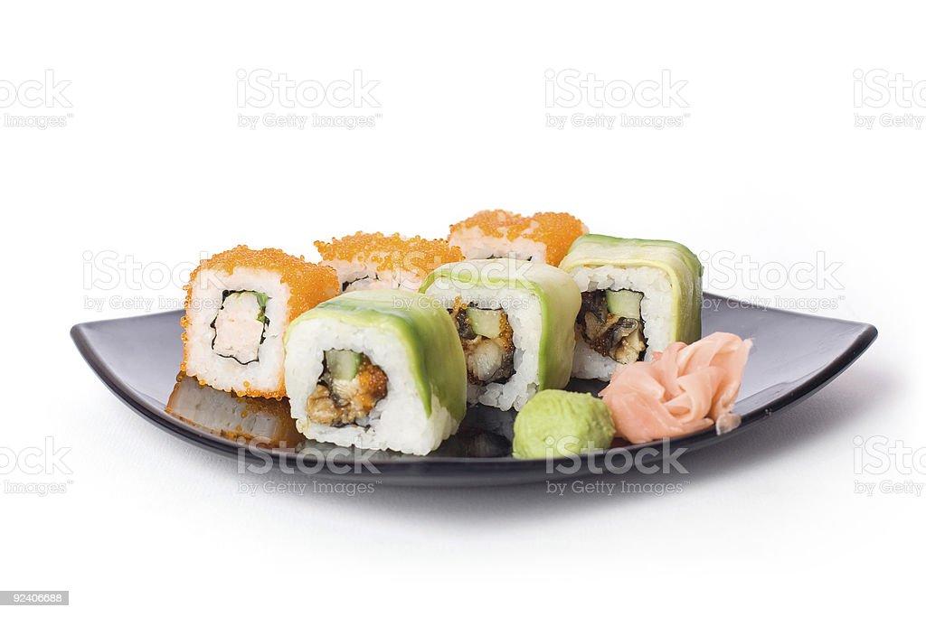 Maki-sushi on black plate stock photo