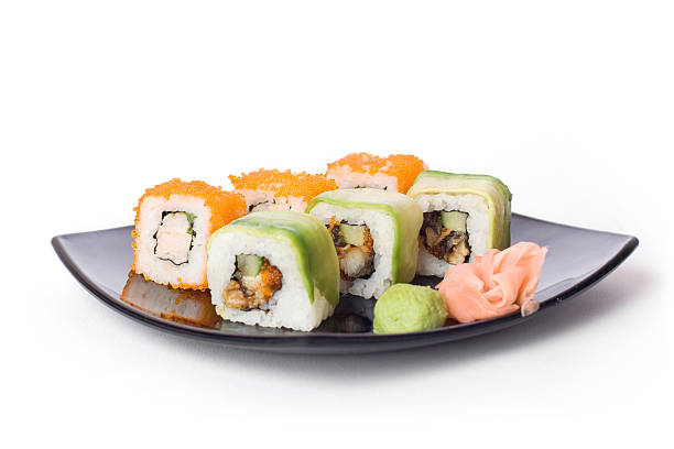 Maki-sushi on black plate stock photo