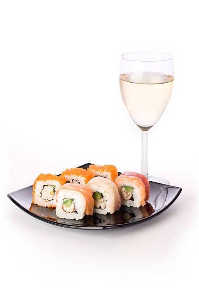 Maki-sushi with a glass of white wine stock photo