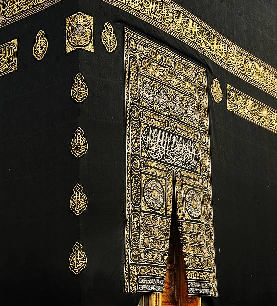 Makkah Kaaba Door with verses from the Koran in gold Makkah Kaaba Door with verses from the Koran holy book in gold circumambulation stock pictures, royalty-free photos & images