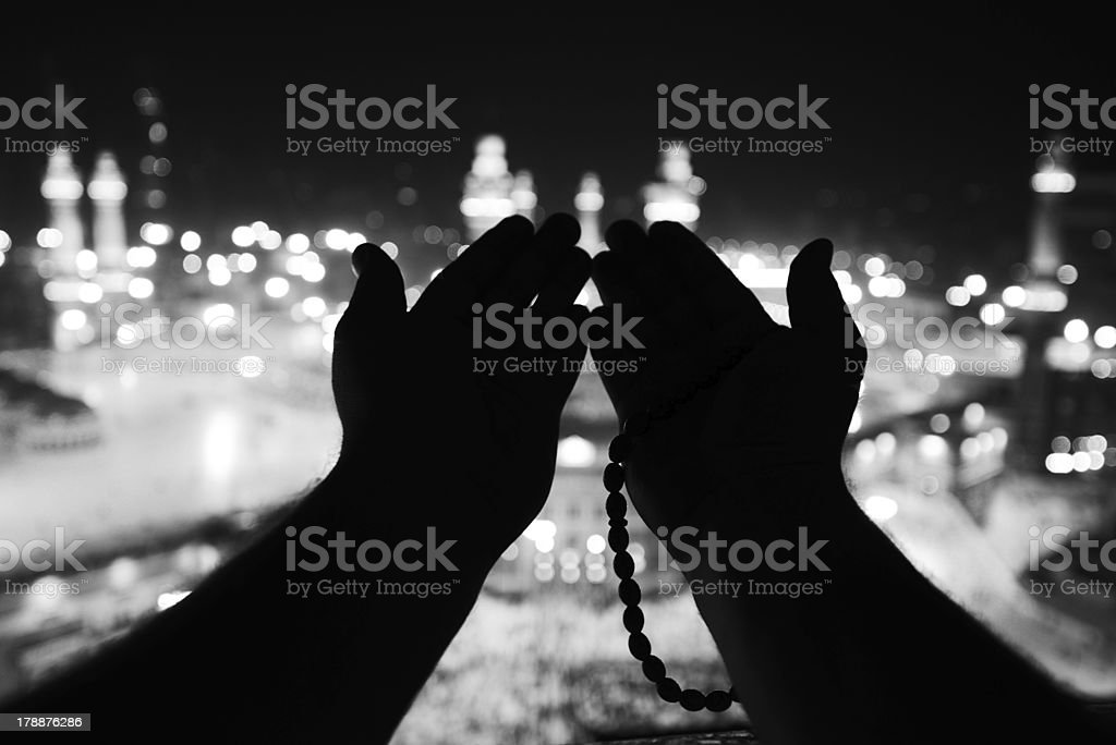 Makkah Kaaba Hajj Muslims, silhouette of hands praying stock photo
