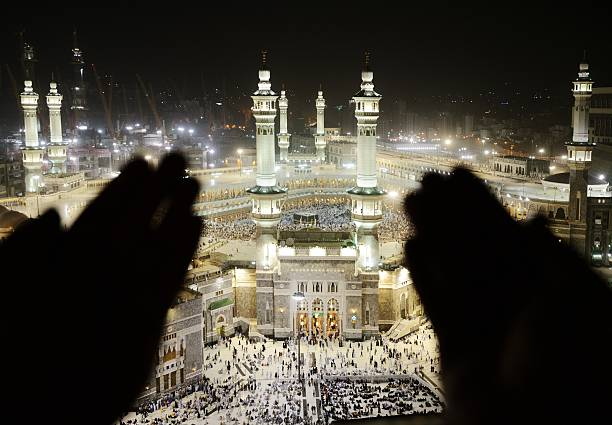 Makkah Kaaba Hajj Muslims, silhouette of hands praying Islamic Holy Place circumambulation stock pictures, royalty-free photos & images