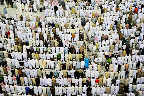 Makkah Kaaba Muslims praying together Islamic Holy Place, people praying circumambulation stock pictures, royalty-free photos & images