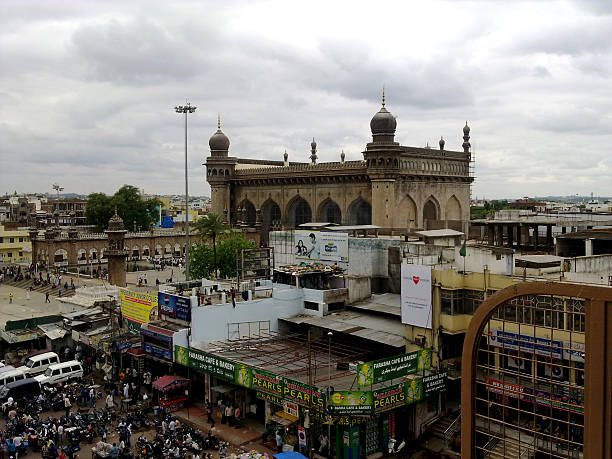Makkah Mosque from charminar hyderabad Hydrabad, India - July 1, 2015: View of the Makkah masjid mosque from Charminar in Hyderabad.  char minar stock pictures, royalty-free photos & images