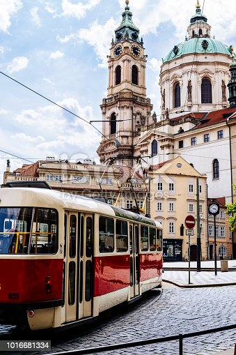 A street photography of a tram moving in Mala Strana district, the oldest district in Prague.