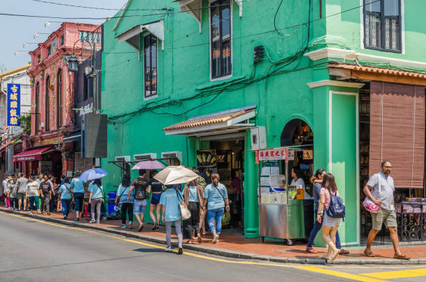Malacca,Malaysia - April 21,2019 : Jonker Street is the centre street of Chinatown in Malacca. It was listed as a UNESCO World Heritage Site on 7 July 2008. People can seen exploring around it. stock photo