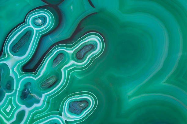 Malachite Abstract Background Macro of slab of malachite backlit and light painted.SEE SIMILAR: malachite stock pictures, royalty-free photos & images