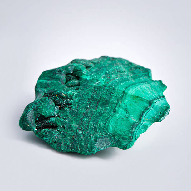 """Malachite mineral """"Malachite mineral, isolated on grey background"""" malachite stock pictures, royalty-free photos & images"""