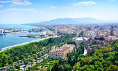 Malaga cityscape with Cathedral of Malaga and harbor, Spain