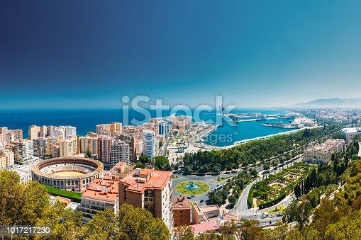Malaga, Spain. Cityscape Topped View Of Malaga. Plaza De Toros De Ronda Bullring In Malaga, Spain.