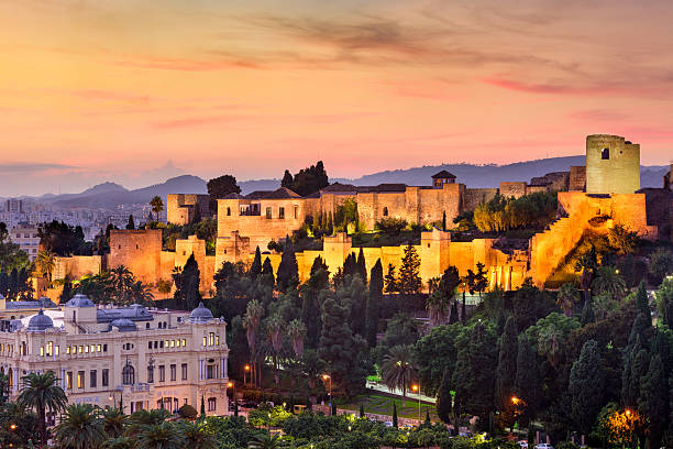 Malaga, Spain Moorish Castle Malaga, Spain - November 2, 2014: The Alcazaba after sunset. The moorish citadel dates from the 11th century and is considered the best preserved of its type.  alcazar palace stock pictures, royalty-free photos & images