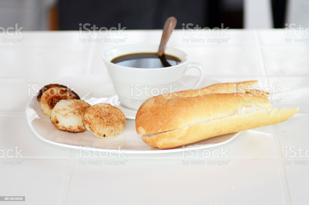 Malagasy donuts from Madagascar with coffee: mofogasy and ramanonaka...