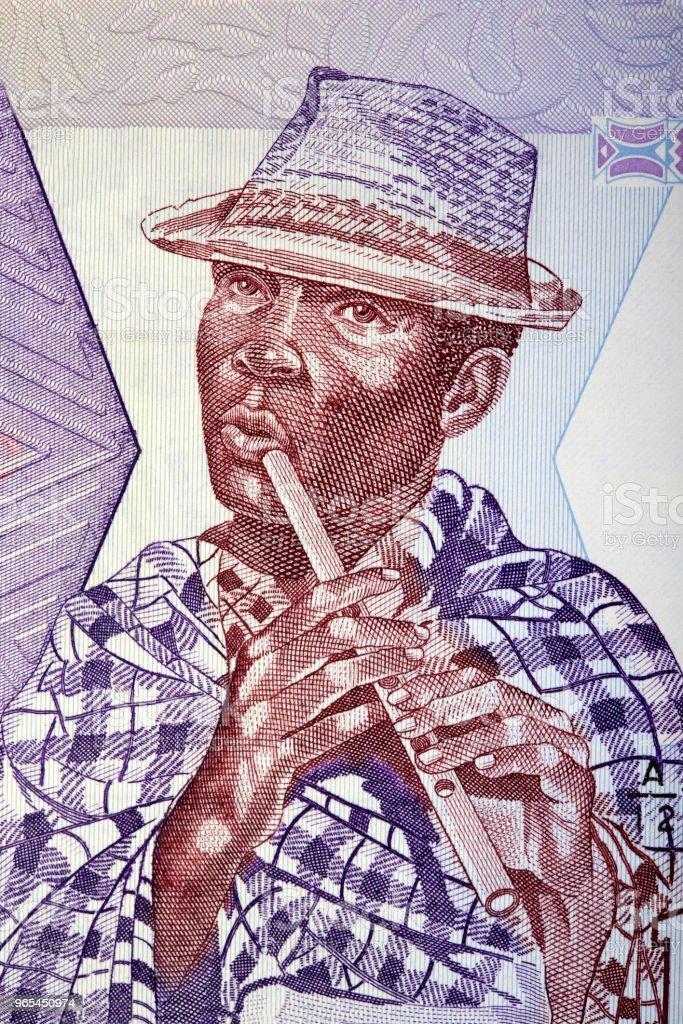 Tocador de flauta malgaxe com um chapéu, um retrato - Foto de stock de Finanças royalty-free