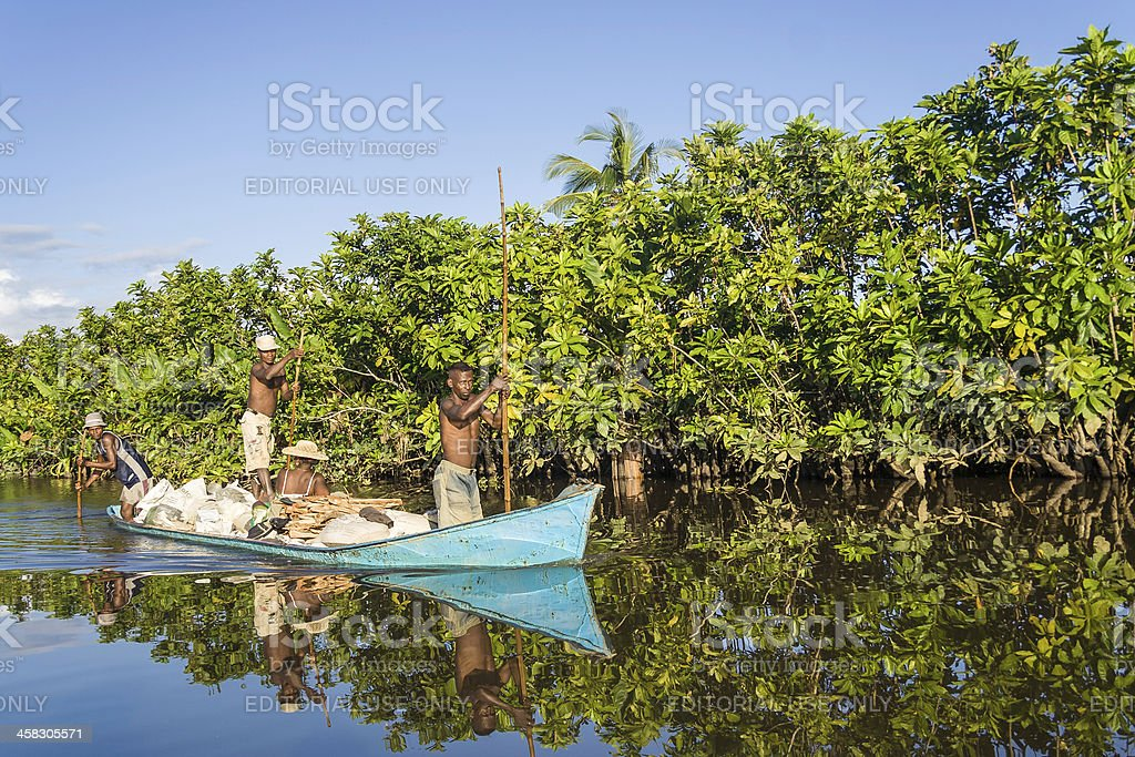 Malagasy people paddling royalty-free stock photo