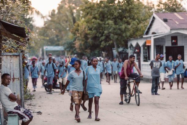 Malagasy students on Maroantsetra street, Madagascar stock photo