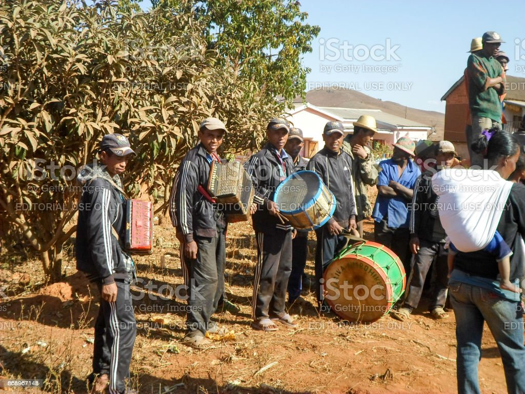 Malagasy traditional musicians playing folk music during the rite of 'famadihana' (exhumation) in the highlands stock photo