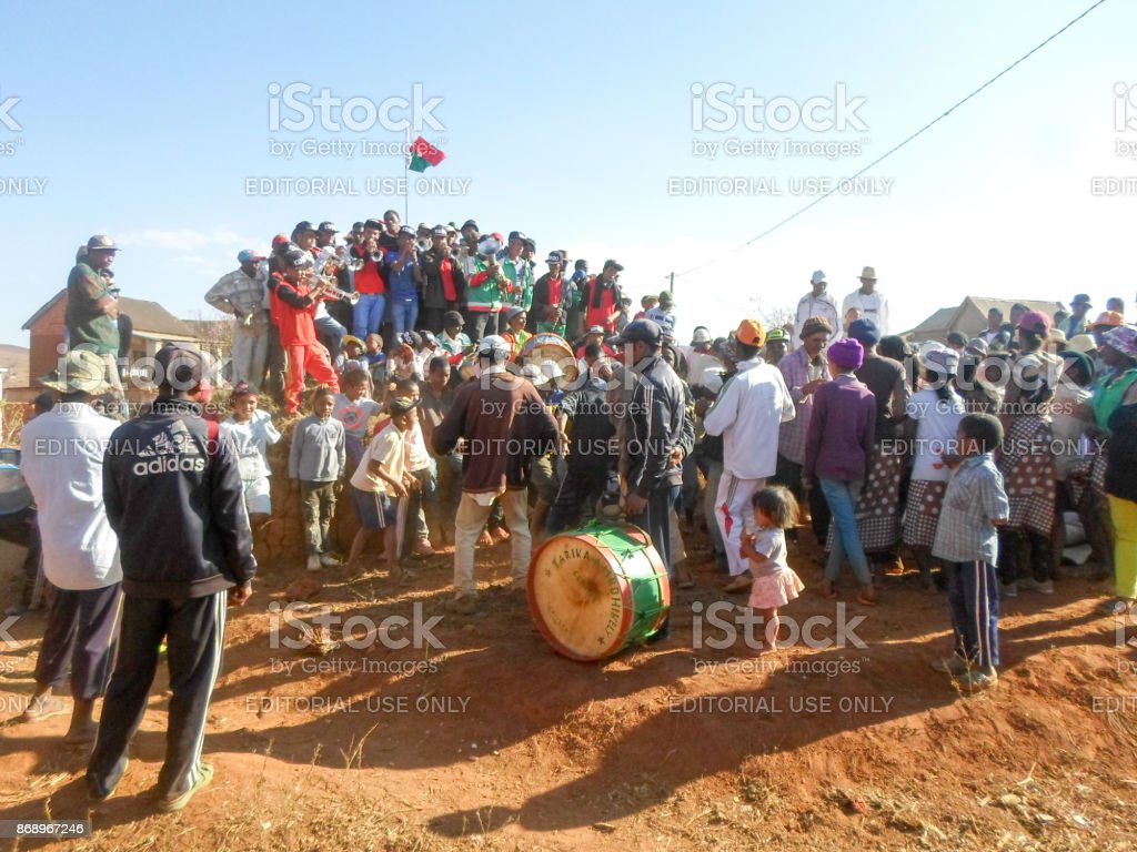 Malagasy traditional musicians playing on a grave during the rite of 'famadihana' (exhumation) in the highlands stock photo