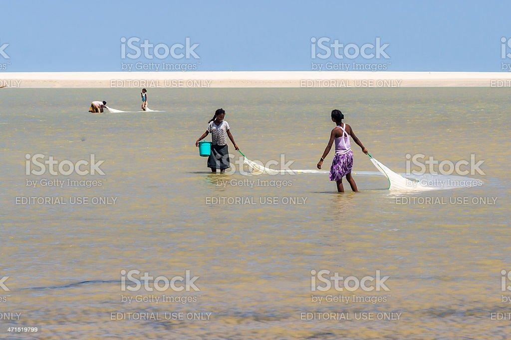 Malagasy women fishing royalty-free stock photo
